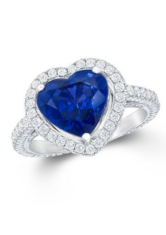 Graff heart-shaped sapphire engagement ring featuring tapered baguette diamond shoulders.