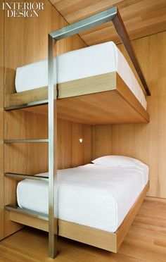 A steel ladder supports and stabilizes cantilevering white-oak bunks in an alcove.