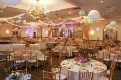Nothing transforms a party room quite like  gold Chiavari Chairs. Rent them at SatinChairCovers.com rental
