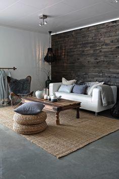 Reclaimed wood wall in living room. Svenngården