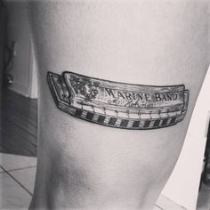 Harmonica tattoo on the right thigh.