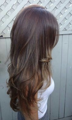 Long thin hair cut with layers and wavy curl ends - perfect color too!
