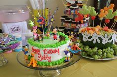 Dessert table for Gabby's Mickey Mouse clubhouse birthday party:) fruit salad, cake, cupcakes and Oreo dessert!