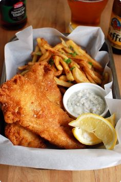Fish 'n Chips is the most popular take-away food in the United Kingdom, Ireland, and colonies of these nations. It consists of battered and deep-fried fish, served with chips (fries), sometimes drizzled in vinegar, sprinkled with salt and served in newspaper.