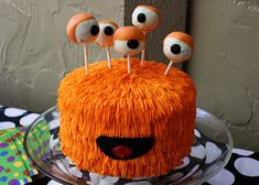 super fun monsters ink type cake - cake pops are the eyes.. maybe make mini cake like this and have cake pop eyes for the kids..