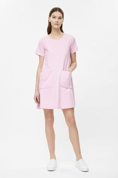 A wide A-line shape, this casual dress is made from stretchy cotton-mix jersey with two relaxed pockets on the front. A loose-fit with neat short sleeves, it has a simple round neckline and cleanly finished edges.