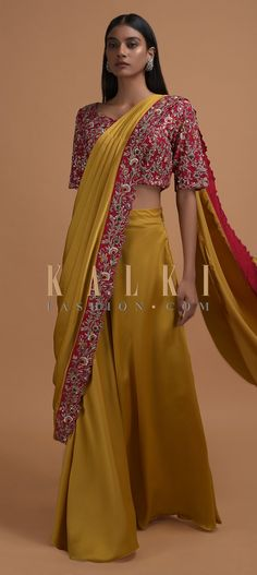 Buy Online from the link below. We ship worldwide (Free Shipping over US$100)  Click Anywhere to Tag Mustard Yellow Ready Pleated Saree In Milano Satin With Red Embellished Blouse Online - Kalki Fashion Mustard yellow ready pleated saree in Milano satin.Topped with a ready stitched draped pallu with resham and cut dana embroidered red border in floral pattern.
