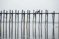 U Bein Bridge, Amarapura, Myanmar  This crossing over Taungthaman Lake was built around 1850 and is almost 0.75 miles in length. The structure consists of 1,086 teakwood pillars that were built from the wood reclaimed from the former royal palace in Inwa