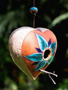 Unique pottery birdhouse features rich contrast of vivid blues set against natural terracotta with an eggshell textured side. A soothing pallet in the landscape for both birds and their hosts alike! E