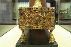 """The altario reliquary of St. Andrew, 10th Century.  The Trier goldsmith was to combine two classical types of sacred object with each other: a reliquary, more exactly a """"speaking"""" reliquary, and a portable altar. The goldsmith fulfilled the first task by creating a richly ornamented rectangular oak case on which an life-like model of the Apostle's foot covered with chased gold was fixed to the lid. used to have mass read when they were at home."""