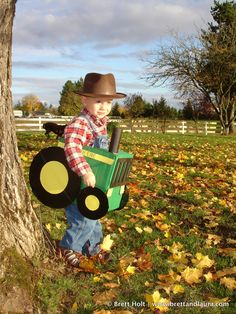 My 2 year old son enjoys his homemade John Deere Tractor Costume. More of this costume at http://www.brettandlaura.com/2010/10/24/fire_engine_costume/