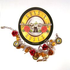 GUNS AND ROSES Charm Bracelet Rock n Roll Icon Band. $15.00, via Etsy.