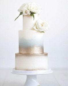 We love this contemporary and chic wedding cake with metallic detail... What type of cake filling are you having? ✨www.wed2b.com