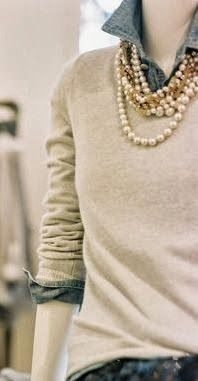 Denim shirt...layered w/ a sweater and pearls.