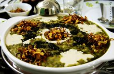 The ash (soup) shows the importance of food  to the Iranian culture. The way it is presented shows the significance of the presentation of food. #APphoto
