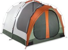 """REI Kingdom 4 Tent. 4 person camping tent really comfy for 2 people. Fits a queen sized air mattress with plenty of room to spare. Mesh in front section and small skinny mesh panels from top to bottom of tent on back section for ventilation. Rain fly includes a small flap that can be pulled out in front of doors. Small mat in front of door for muddy shoes. Fit my blue hawk box and other items underneath the flap. Hubby is 5'11"""" and he can fully stand in the tent."""