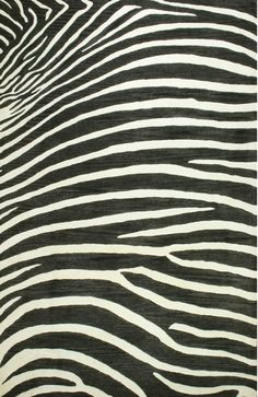 Made by Jaunty Rugs. Safari Serengeti wool rug. Sold by Design Avenue asheville