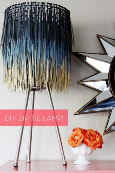 Hmm, I may have to do this one...  This is made with zip ties! I know you can get bags of these @ Dollar Tree. What next? Sooo Cool! How To: Make a Stylish DIY Zip Tie Lamp Shade!