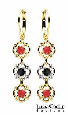 Lucia Costin 14K Yellow Gold Plated over .925 Sterling Silver Dangle Earrings Designed with 4 Petal Flowers Enhanced with Red and Black Swarovski Crystal Accents; Handmade in USA Lucia Costin. $36.00. Unique jewelry handmade in USA. Garnished with deep green and purple Swarovski crystals. Irresistible Dangle earrings by Lucia Costin. Update your everyday style with inspiration when wearing this piece of jewelry. Flowers and fancy ornaments beautifully combined