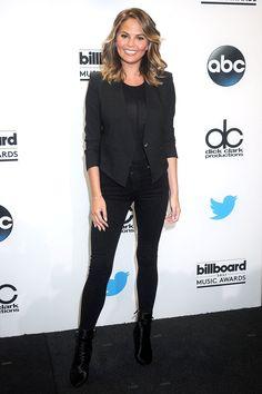 Chrissy Teigen stuns in all black announcing the 2015 Billboard Music Awards finalists.