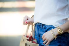 Effortless summer style; denim shorts, a neutral top and neutral accessories- The Samantha Show