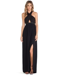 Black Pleated Halter Maxi Dress A elegant modern design black halter maxi dress with pleated detail, vegan leather trim, cut out in front and open back, back zip. MSRP: $228.00