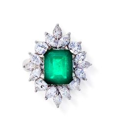 An emerald and diamond ring centering a cut-cornered rectangular-cut emerald, weighing 2.57 carats, within a marquise and heart-shaped diamond surround; estimated total diamond weight: 2.10 carats; mounted in eighteen karat white gold Emerald Jewelry, Gems Jewelry, Diamond Jewelry, Jewelry Accessories, Fine Jewelry, Jewelry Design, Emerald Rings, Diamond Brooch, Jewellery