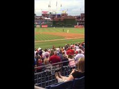 Squirrel at Philadelphia Phillie's baseball game does a tight rope walk and then flies into the dugout which makes some players run for cover. | Real Funny