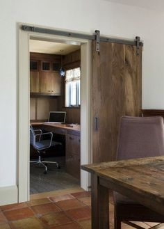 I love both the one-panel sliding door, and I love the sort of unfinished quality to the hardwood. I definitely want to do my office doorway like this.