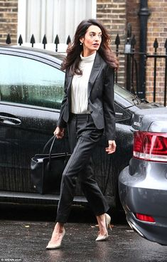 Leggy look: The 37-year-old human rights lawyer accentuated her slender legs with nude stilettos
