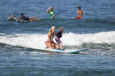 99b0b926210be8 Surf lessons for all ages in Maui Hawaii! Girls catching waves   StandupPaddleBoarding Lahaina Maui