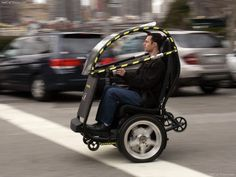 General Motors is teaming with Segway, the scooter company, to develop a battery-powered vehicle to cut urban congestion and pollution. Cool Technology, Technology Gadgets, Technology Gifts, General Motors, Tricycle, Tech Toys, Cool Inventions, Electric Scooter, Electric Car