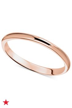Rose gold wedding bands are having a serious moment right now. Brides and grooms alike are rocking this pinky hue. We especially like the simple design of this polished 14k rose gold band. Find it available at macys.com.