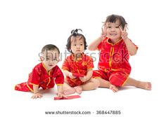 Cute Asian baby boy and girl in traditional Chinese suit Isolated on white background, Chinese New Year Concept