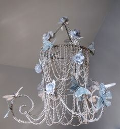 Imagine your little girl looking up at night right before bed and seeing sparkling butterflies hovering above her head. This chandelier is perfect for any little girl who loves sparkles, flowers and butterflies. I'm pretty sure that includes them all. In fact, you don't even need to install a light.