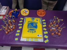Golden State Warriors bday party. Basketball cake pops with different basketball terms on it it and the tags around the cake were just the different players from the team.