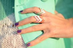 Love everything: nail color, the mint jacket, the rings <3