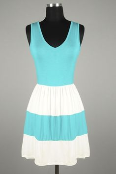 *** New Style *** Flirty Sleeveless Fit and Flare Dress with Cinched Waist and Color Block Skirt.