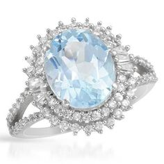 Pleasant Ring With Topaz - Size 6 Pleasant ring with cubic zirconia and topaz beautifully crafted in 925 Sterling silver. Total item weight 4.4g. Gemstone Info: 80 cubic zirconia, 1.30ctw., multi-shaped and white color, 1 topaz, 4.15ctw., oval shape and blue color.