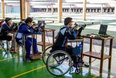 France's Cedric Fevre FRA (right) compees in the R6 - Mixed 50m Rifle Prone SH1 qualifying competition at the Olympic Shooting Centre during the Paralympic Games, in Rio de Janeiro, Brazil, on September 14, 2016.   Photo by Thomas Lovelock for OIS/IOC via AFP. RESTRICTED TO EDITORIAL USE. / AFP / OIS/IOC / Thomas Lovelock for OIS/IOC