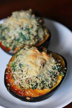 Quinoa Stuffed Acorn Squash~ 1 acorn squash 1/2 pound extra lean ground turkey 9 oz frozen spinach, thawed and drained 2 oz goat cheese 1 tsp dried minced onion 1/4 tsp garlic powder 1/2 cup uncooked quinoa 1 cup chicken broth salt pepper 2 tbsp shredded parmesan cheese