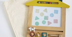 If you ever doubted that toys could actually make our homes more beautiful places, you only have to look at the Oekaki House - Magic Board, a wooden version of the classic magnetic drawing board.