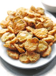 This recipe for Fried Pickles makes a perfectly pleasing palatable plate of goodness. Serve them as an appetizer or a fun side dish at your next party. Just watch them disappear! shewearsmanyhats.com #pickles #fried