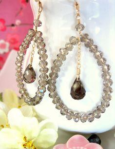 Swarovski crystal smokey quartz tear drop hoop earrings.
