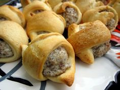 Sausage & Cream Cheese Crescents: 16 oz sausage cooked and crumbled, 8 oz cream cheese softened, and 2 cans of crescent rolls. Mix sausage and cream cheese together. Separate rolls into triangles. Cut eat triangle in half lengthwise. Scoop a heaping tablespoon onto each roll and roll up. Bake at 375 for 15 minutes, or until golden brown. Yum!!