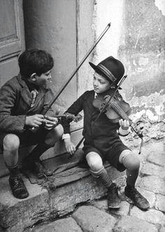 Vintage photo of boys playing violin.