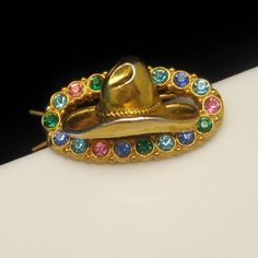 CHARMING VINTAGE RHINESTONE COWGIRL HAIR BARRETTE! What a great gift for a western girl. This cowgirl hat barrette features a frame of colorful rhinestones. $44.95. See more great vintage jewelry in my store: http://stores.ebay.com/My-Classic-Jewelry-Shop