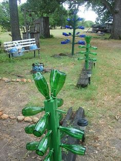 Bottle Trees...I've made several..one is all vintage coke bottles with a green insulator on top