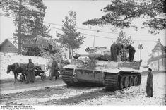 German donkey and horse carts passing by a Tiger I heavy tank in a Russian town, winter of 1943-1944 (PhotographerStöpfgeshoff, German Federal Archive)