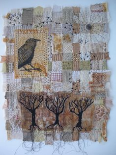"""Artist: Meg Fowler - Season of the Crow - Quilt for the Fiberactions January challenge word, """"Environment."""" Woven base of cottons, linens, silks. Hand stitched, wooden beads, vintage button, and her handcarved stamp."""